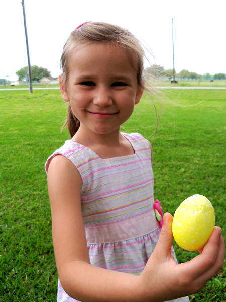 Corina holds a cracked polka-dotted egg.