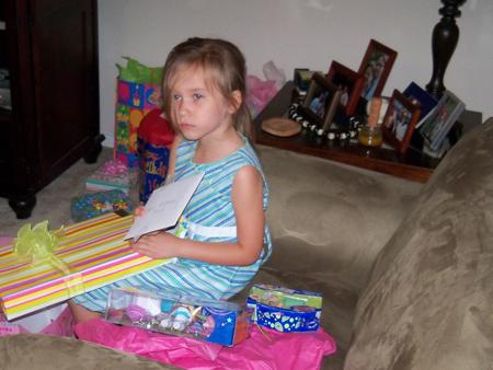 Corina opens presents.