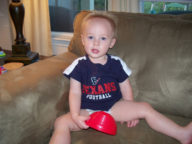 Kim wants it to be known that she took this photo, of Marshall, in his Texans shirt, before their pre-season opener. Is he a football fan? Time will only tell, but he really didn't seem that interested in it all but that's from a biased source, so ...